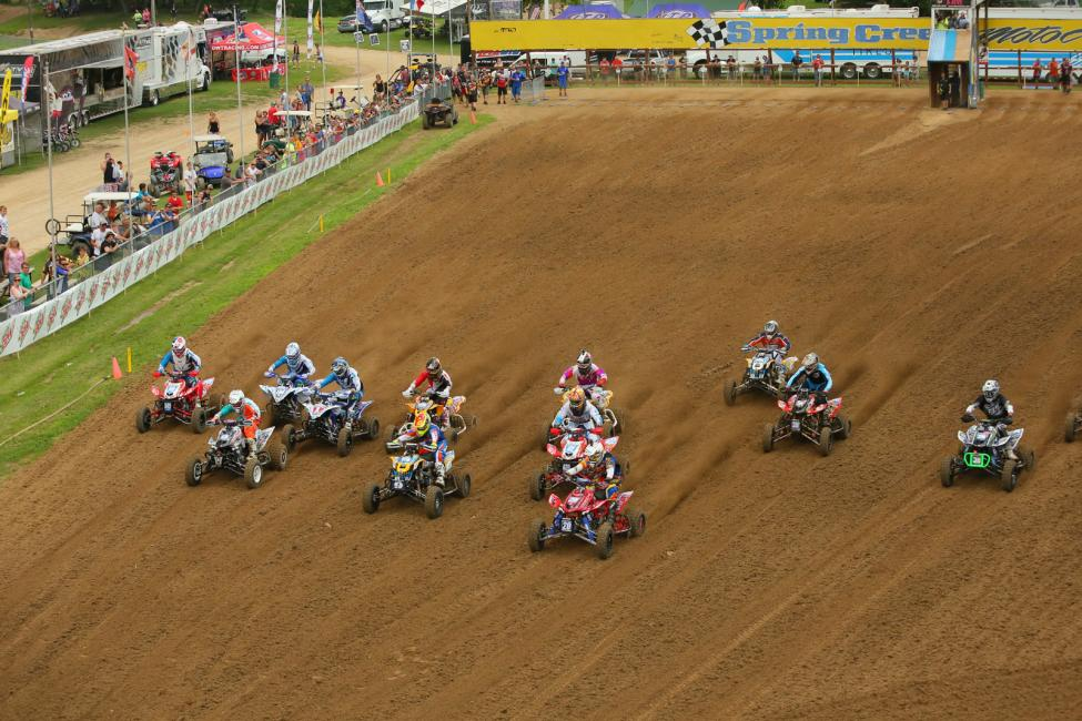 The AMA Pro ATV field tears down the long Spring Creek start straight.